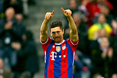 Robert Lewandowski of Muenchen celebrates scoring the first team goal during the Bundesliga match between FC Bayern Muenchen and Borussia Dortmund at...
