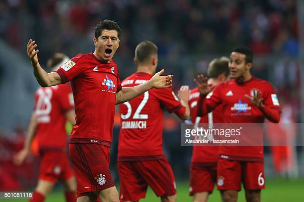 Robert Lewandowski of Muenchen celebrates scoring the opening goal during the Bundesliga match between FC Bayern Muenchen and FC Ingolstadt at...