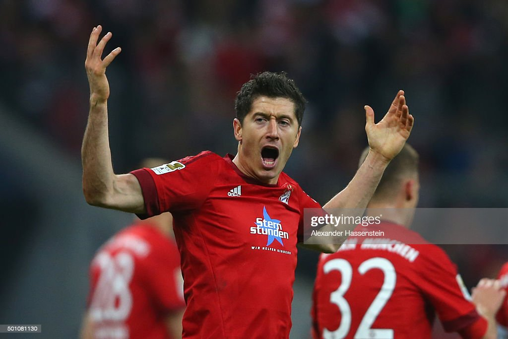 Robert Lewandowski of Muenchen celebrates scoring the opening goal during the Bundesliga match between FC Bayern Muenchen and FC Ingolstadt at Allianz Arena on December 12, 2015 in Munich, Germany.