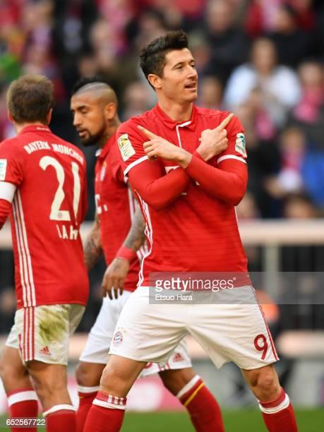 Robert Lewandowski of Muenchen celebrates scoring the opening goal during the Bundesliga match between Bayern Muenchen and Eintracht Frankfurt at...