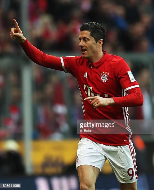 Robert Lewandowski of Muenchen celebrates scoring the second goal during the Bundesliga match between Bayern Muenchen and VfL Wolfsburg at Allianz...