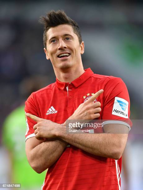 Robert Lewandowski of Muenchen celebrates scoring the third goal during the Bundesliga match between VfL Wolfsburg and Bayern Muenchen at Volkswagen...