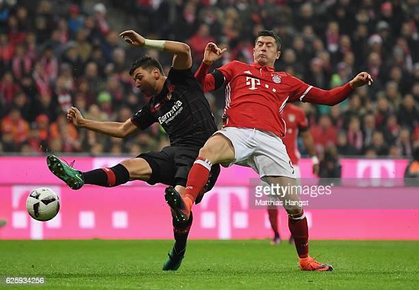 Robert Lewandowski of Muenchen challenges Aleksandar Dragovic of Bayer 04 Leverkusen during the Bundesliga match between Bayern Henchmen and Bayer 04...