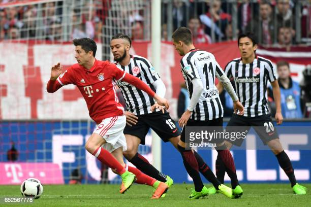 Robert Lewandowski of Muenchen controls the ball under pressure of Frankfurt defense during the Bundesliga match between Bayern Muenchen and...