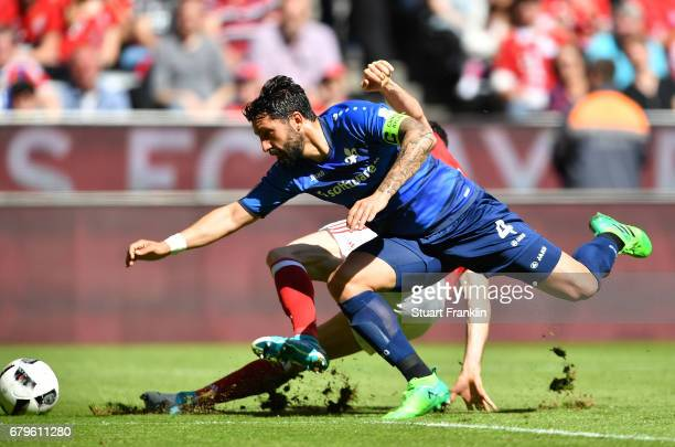 Robert Lewandowski of Muenchen is challenged by Aytac Sulu of Dramstadt during the Bundesliga match between Bayern Muenchen and SV Darmstadt 98 at...