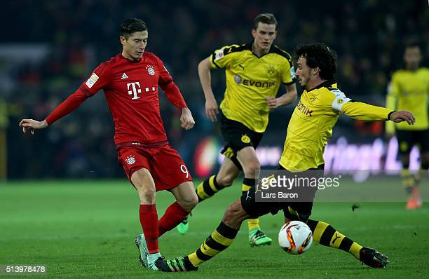 Robert Lewandowski of Muenchen is challenged by Mats Hummels of Dortmund during the Bundesliga match between Borussia Dortmund and FC Bayern Muenchen...