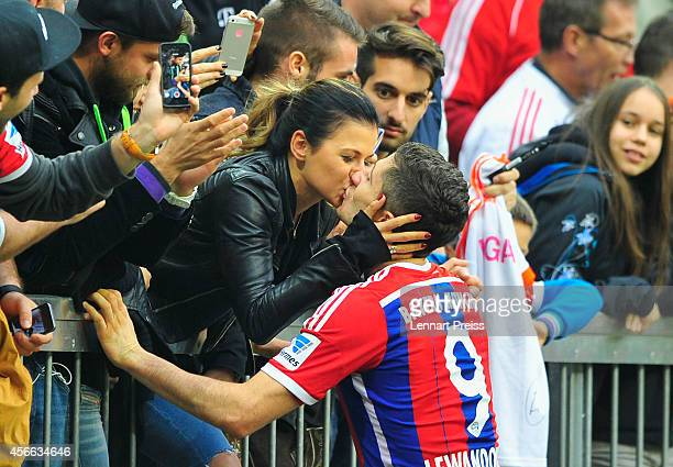 Robert Lewandowski of Muenchen kisses his wife Anna Stachurska after the Bundesliga match between FC Bayern Muenchen and Hannover 96 at Allianz Arena...