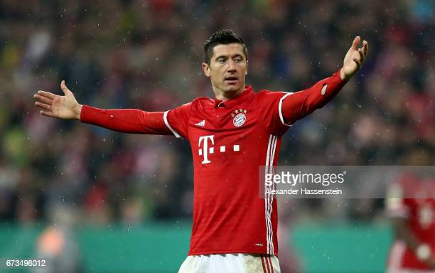 Robert Lewandowski of Muenchen reacts during the DFB Cup semi final match between FC Bayern Muenchen and Borussia Dortmund at Allianz Arena on April...