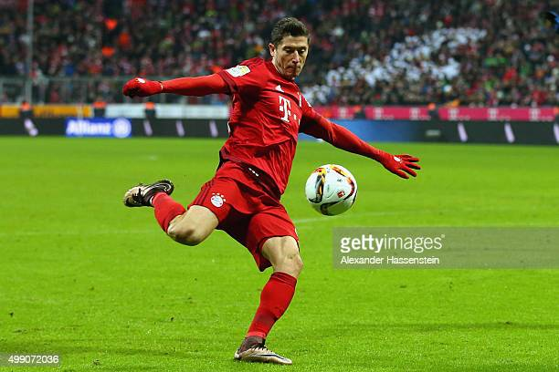 Robert Lewandowski of Muenchen runs with the ball during the Bundesliga match between FC Bayern Muenchen and Herha BSC Berlin at Allianz Arena on...