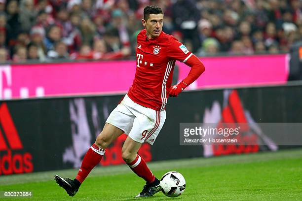 Robert Lewandowski of Muenchen runs with the ball during the Bundesliga match between Bayern Muenchen and RB Leipzig at Allianz Arena on December 21...