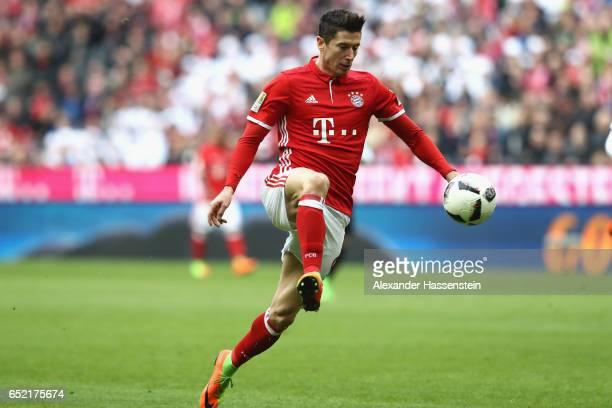 Robert Lewandowski of Muenchen runs with the ball during the Bundesliga match between Bayern Muenchen and Eintracht Frankfurt at Allianz Arena on...