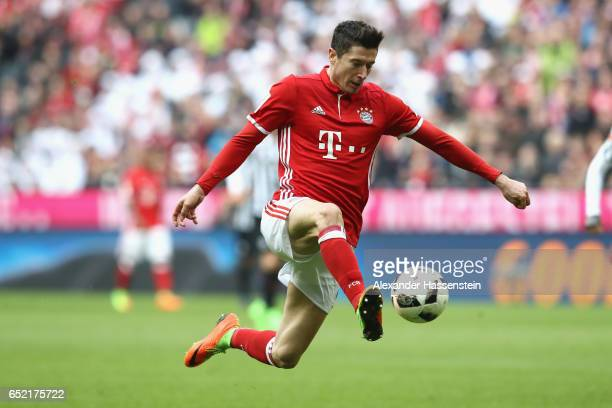 Robert Lewandowski of Muenchen runs with the ball during the Bundesliga match between Bayern Muenchen and Eintracht Frankfurt at Allianz Arena on...