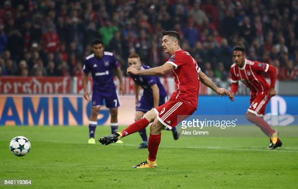 Robert Lewandowski of Muenchen scores his team's first goal by penalty during the UEFA Champions League group B match between Bayern Muenchen and RSC...