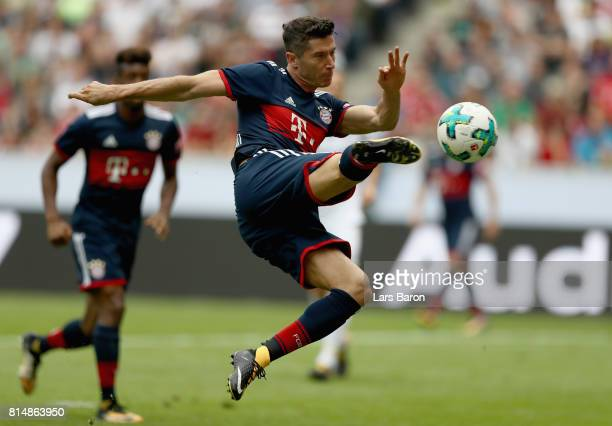 Robert Lewandowski of Muenchen scores his teams first goal during the Telekom Cup 2017 match between Bayern Muenchen and 1899 Hoffenheim at on July...