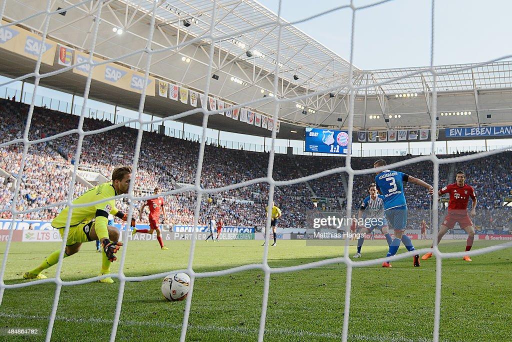 Robert Lewandowski of Muenchen scores his team's second goal past goalkeeper Oliver Baumann of Hoffenheim during the Bundesliga match between 1899...