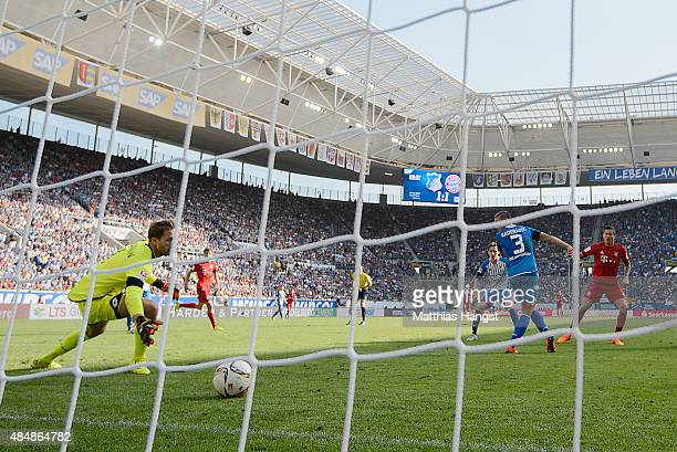 Robert Lewandowski of Muenchen scores his team's second goal past goalkeeper Oliver Baumann of Hoffenheim during the Bundesliga match between 1899...