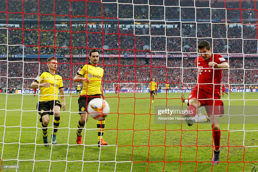 <a gi-track='captionPersonalityLinkClicked' href=/galleries/search?phrase=Robert+Lewandowski&family=editorial&specificpeople=5532633 ng-click='$event.stopPropagation()'>Robert Lewandowski</a> of Muenchen scores the 3rd team goal against <a gi-track='captionPersonalityLinkClicked' href=/galleries/search?phrase=Mats+Hummels&family=editorial&specificpeople=595395 ng-click='$event.stopPropagation()'>Mats Hummels</a> (C) of Dortmund and his team mate <a gi-track='captionPersonalityLinkClicked' href=/galleries/search?phrase=Lukasz+Piszczek&family=editorial&specificpeople=4380352 ng-click='$event.stopPropagation()'>Lukasz Piszczek</a> during the Bundesliga match between FC Bayern Muenchen and BVB Borussia Dortmund at Allianz Arena on October 4, 2015 in Munich, Germany.