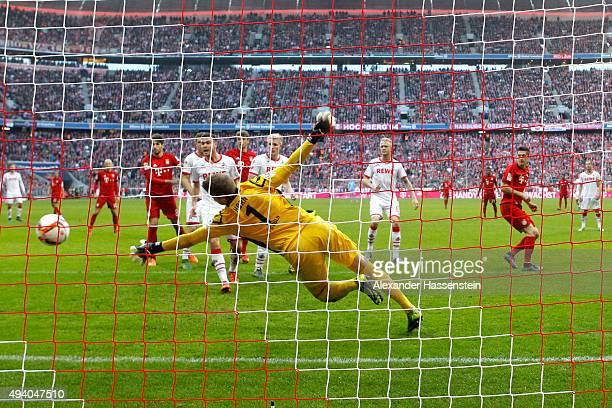 Robert Lewandowski of Muenchen scores the 3rd team goal against Timo Horn keeper of Koeln during the Bundesliga match between FC Bayern Muenchen and...
