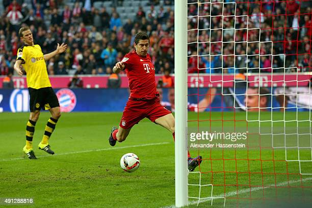 Robert Lewandowski of Muenchen scores the 3rd team goal during the Bundesliga match between FC Bayern Muenchen and BVB Borussia Dortmund at Allianz...