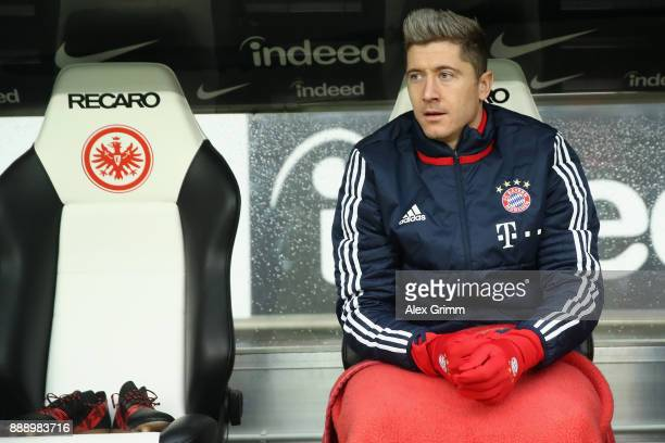 Robert Lewandowski of Muenchen sits on the bench prior to the Bundesliga match between Eintracht Frankfurt and FC Bayern Muenchen at CommerzbankArena...