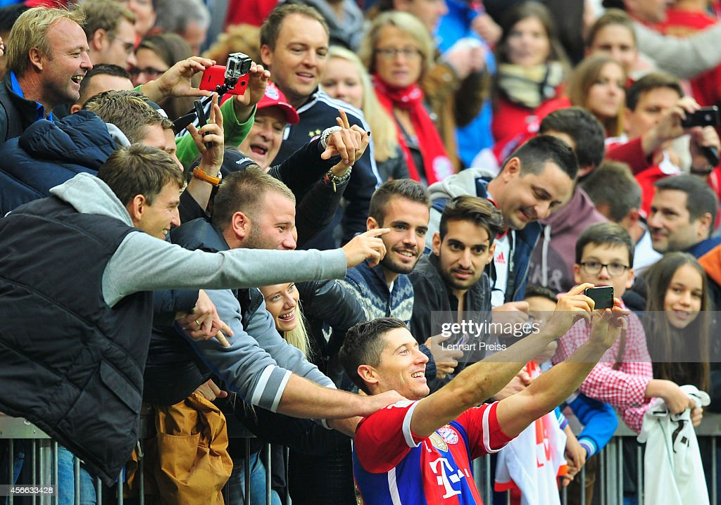 <a gi-track='captionPersonalityLinkClicked' href=/galleries/search?phrase=Robert+Lewandowski&family=editorial&specificpeople=5532633 ng-click='$event.stopPropagation()'>Robert Lewandowski</a> (C) of Muenchen takes a selfie picture with fans after the Bundesliga match between FC Bayern Muenchen and Hannover 96 at Allianz Arena on October 4, 2014 in Munich, Germany.
