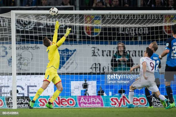 Robert Lewandowski of Muenchen tries to score against Oliver Baumann of Hoffenheim during the Bundesliga match between TSG 1899 Hoffenheim and Bayern...