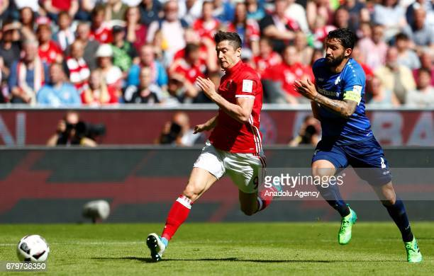 Robert Lewandowski of Munich and Aytac Sulu of Darmstadt fight for the ball during the Bundesliga first division soccer match between Bayern Munich...