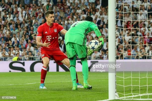 Robert Lewandowski of Munich and Goalkeeper Keylor Navas of Real Madrid battle for the ball during the UEFA Champions League Quarter Final second leg...