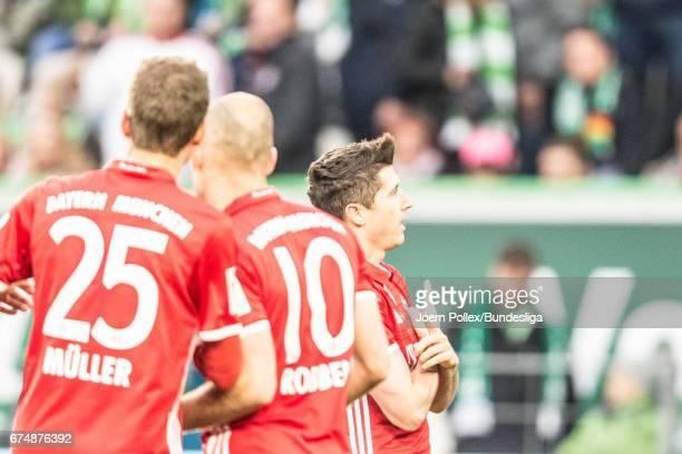 Robert Lewandowski of Munich celebrates after scoring a goal during the Bundesliga match between VfL Wolfsburg and Bayern Muenchen at Volkswagen...