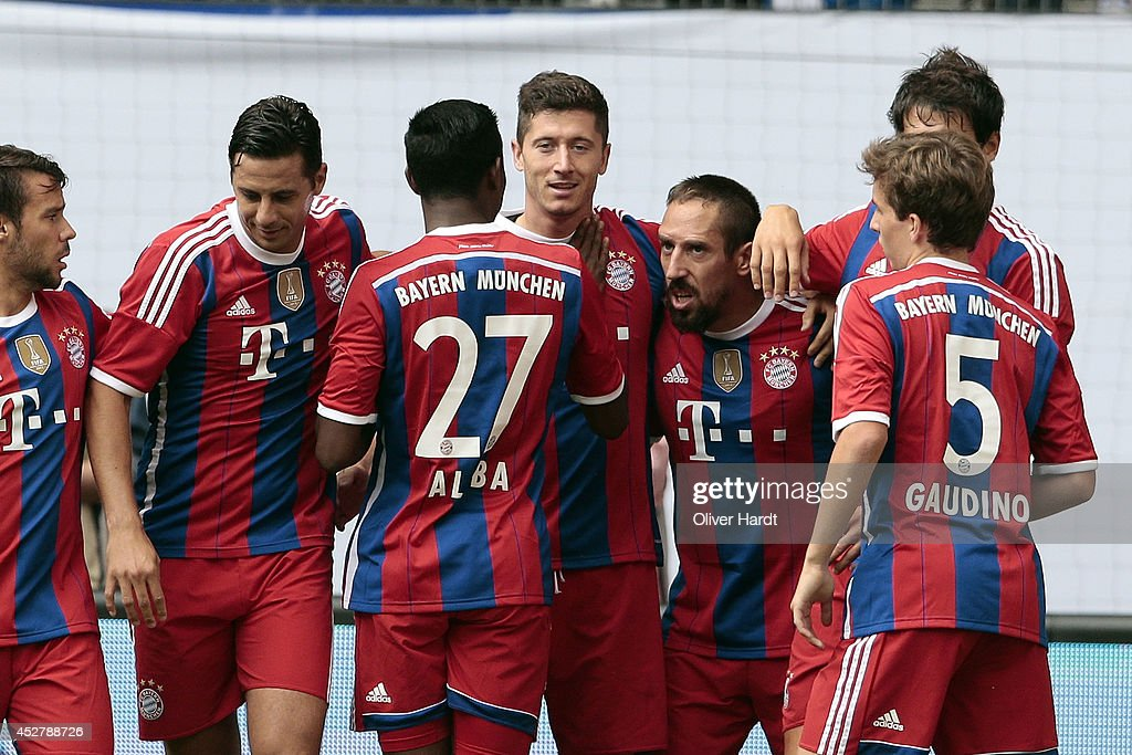 Robert Lewandowski of Munich celebrates after scoring their first goal during the Telekom Cup 2014 Finale match between FC Bayern Muenchen and...