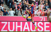 Robert Lewandowski of Munich celebrates scoring the opening goal during the Bundesliga match between FC Bayern Muenchen and Eintracht Frankfurt at...
