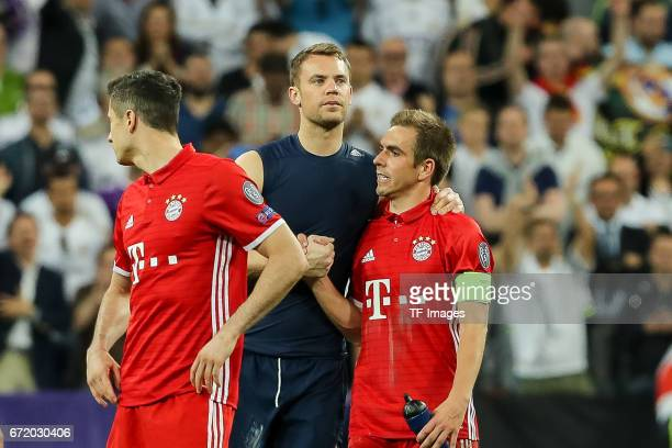 Robert Lewandowski of Munich Goalkeeper Manuel Neuer of Munich Philipp Lahm of Munich looks dejected during the UEFA Champions League Quarter Final...