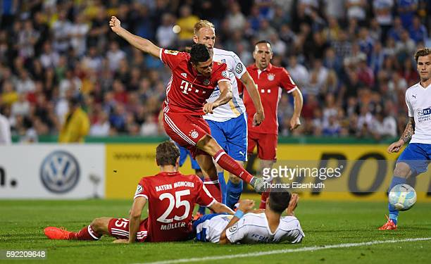 Robert Lewandowski of Munich scores the opening goal during the DFB Cup match between FC Carl Zeiss Jena and Bayern Muenchen at ErnstAbbeSportfeld on...