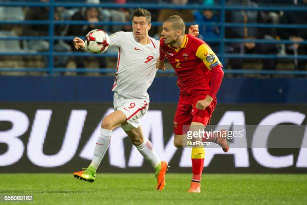 Robert Lewandowski of Poland and Aleksandar Sofranac of Montenegro battle for the ball during the FIFA World Cup 2018 Qualifying Round Group E match...