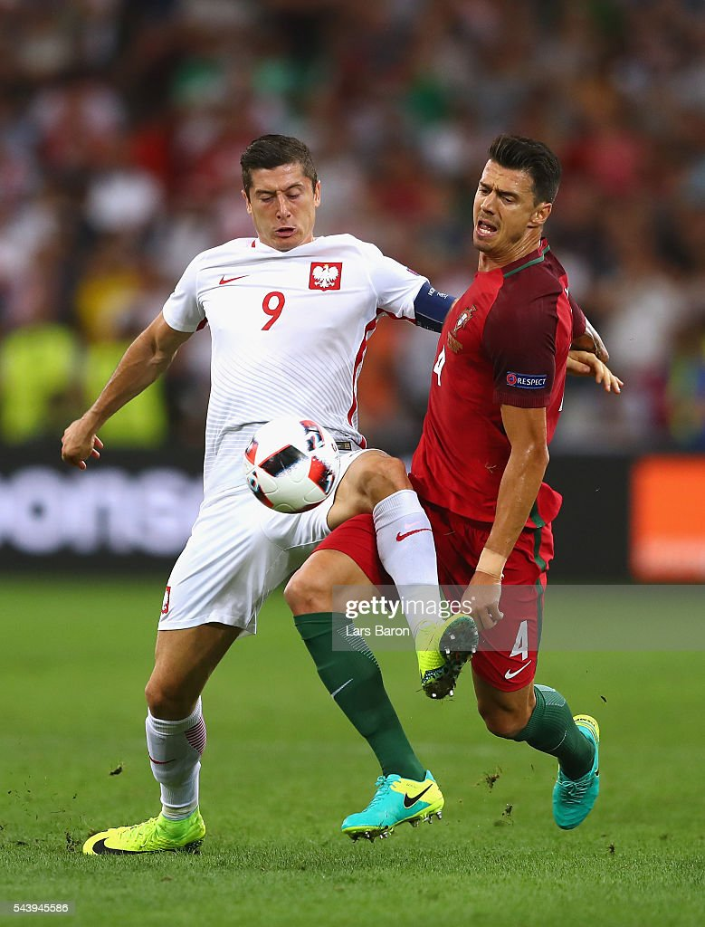 <a gi-track='captionPersonalityLinkClicked' href=/galleries/search?phrase=Robert+Lewandowski&family=editorial&specificpeople=5532633 ng-click='$event.stopPropagation()'>Robert Lewandowski</a> of Poland and Jose Fonte of Portugal compete for the ball during the UEFA EURO 2016 quarter final match between Poland and Portugal at Stade Velodrome on June 30, 2016 in Marseille, France.
