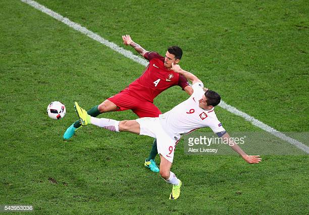 Robert Lewandowski of Poland and Jose Fonte of Portugal compete for the ball during the UEFA EURO 2016 quarter final match between Poland and...