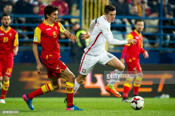 Robert Lewandowski of Poland and Stefan Savic of Montenegro fight for the ball during the FIFA World Cup 2018 Qualifying Round Group E match between...