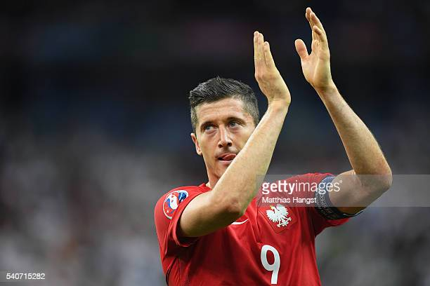 Robert Lewandowski of Poland applauds the supporters after his team's scoreless draw in the UEFA EURO 2016 Group C match between Germany and Poland...