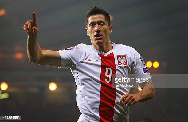 Robert Lewandowski of Poland celebrates after he scores during the UEFA EURO 2016 qualifier between Scotland and Poland at Hampden Park on October 08...