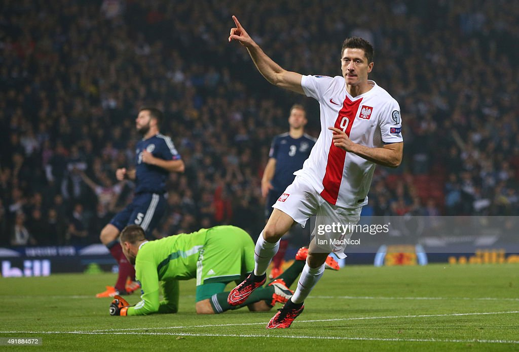 Robert Lewandowski of Poland celebrates after he scores during the UEFA EURO 2016 qualifier between Scotland and Poland at Hampden Park on October 08...