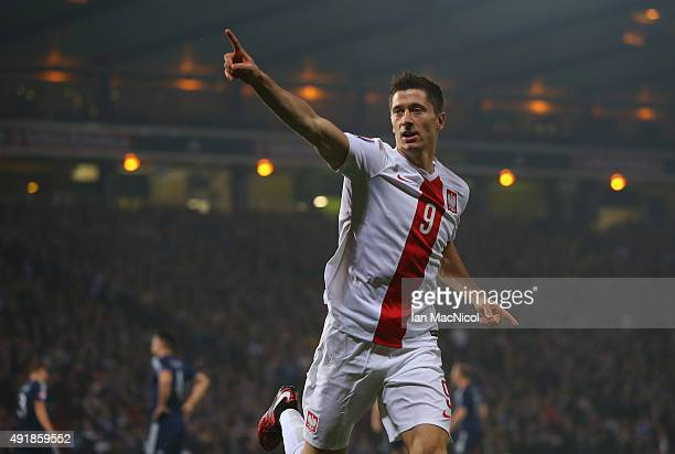 Robert Lewandowski of Poland celebrates after scoring the opening goal during the UEFA EURO 2016 qualifier between Scotland and Poland at Hampden...