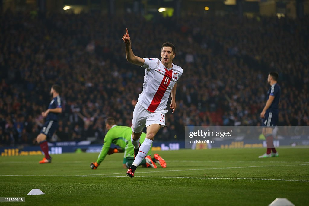 <a gi-track='captionPersonalityLinkClicked' href=/galleries/search?phrase=Robert+Lewandowski&family=editorial&specificpeople=5532633 ng-click='$event.stopPropagation()'>Robert Lewandowski</a> of Poland celebrates after scoring the opening goal during the UEFA EURO 2016 qualifier between Scotland and Poland at Hampden Park on October 08, 2015 in Glasgow, Scotland.