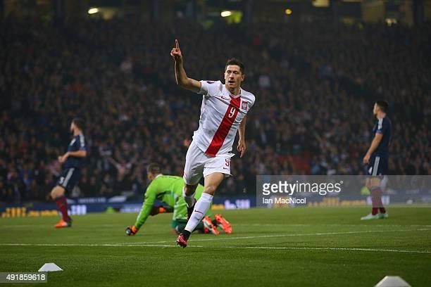 Robert Lewandowski of Poland celebrates after scoring the opening goal during the UEFA EURO 2016 qualifier between Scotland and Poland at Hampden...
