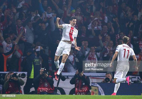 Robert Lewandowski of Poland celebrates scoring a goal early in the first half during the EURO 2016 Qualifier between Scotland and Poland at Hamden...