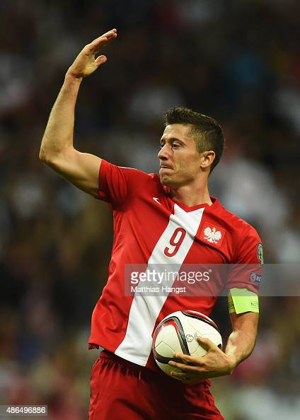 Robert Lewandowski of Poland celebrates scoring his team's opening goal during the EURO 2016 Qualifier Group D match between Germany and Poland at...