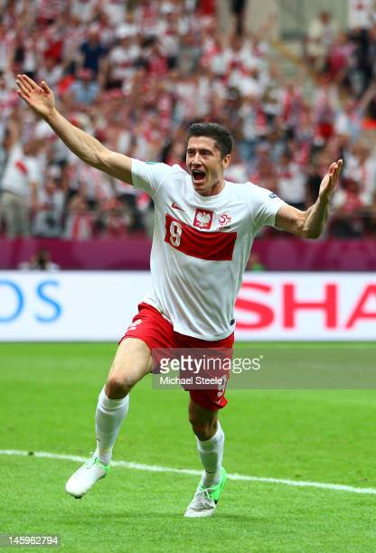 Robert Lewandowski of Poland celebrates scoring the opening goal during the UEFA EURO 2012 Group A match between Poland and Greece at National...