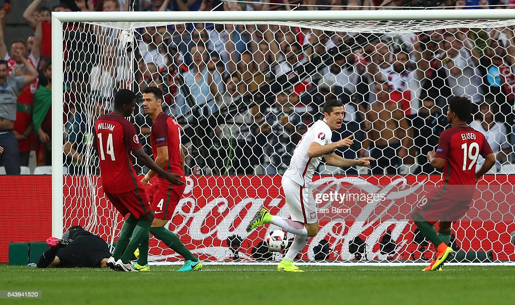 <a gi-track='captionPersonalityLinkClicked' href=/galleries/search?phrase=Robert+Lewandowski&family=editorial&specificpeople=5532633 ng-click='$event.stopPropagation()'>Robert Lewandowski</a> (2nd R) of Poland celebrates scoring the opening goal during the UEFA EURO 2016 quarter final match between Poland and Portugal at Stade Velodrome on June 30, 2016 in Marseille, France.