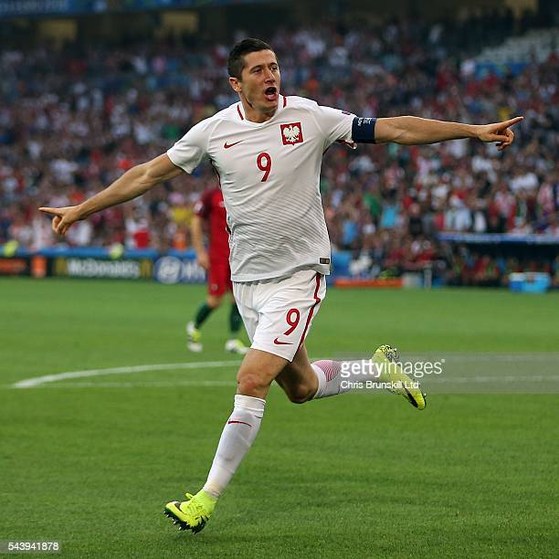 Robert Lewandowski of Poland celebrates scoring the opening goal during the UEFA Euro 2016 Quarter Final match between Poland and Portugal at Stade...