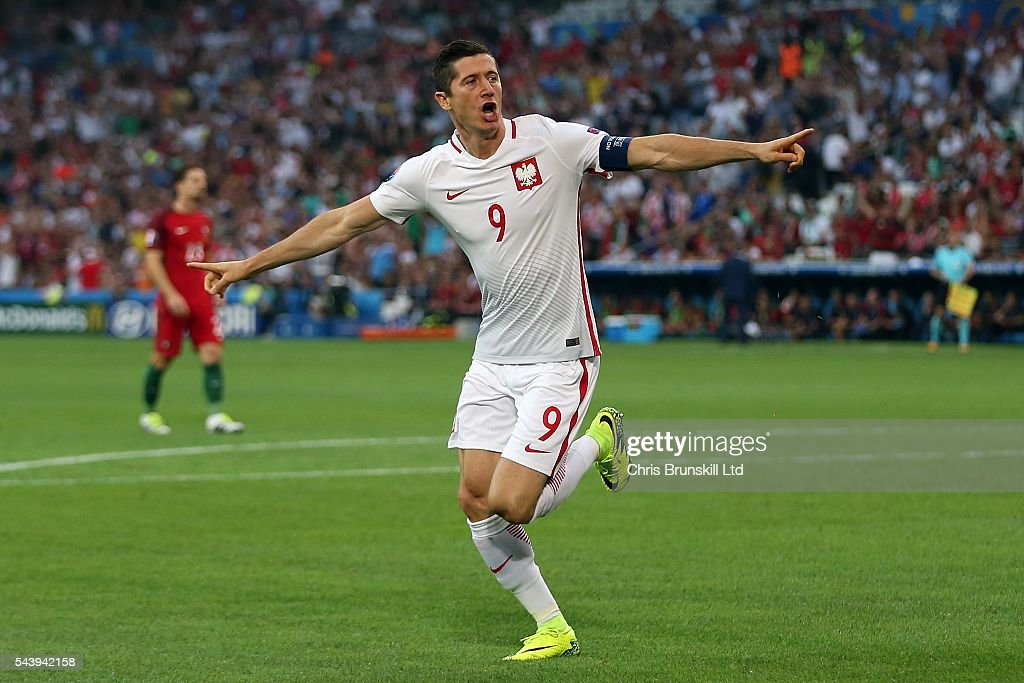 Robert Lewandowski of Poland celebrates scoring the opening goal during the UEFA Euro 2016 Quarter Final match between Poland and Portugal at Stade Velodrome on June 30, 2016 in Marseille, France.