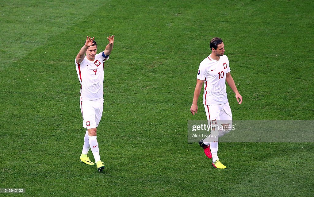<a gi-track='captionPersonalityLinkClicked' href=/galleries/search?phrase=Robert+Lewandowski&family=editorial&specificpeople=5532633 ng-click='$event.stopPropagation()'>Robert Lewandowski</a> (L) of Poland celebrates scoring the opening goal with his team mate <a gi-track='captionPersonalityLinkClicked' href=/galleries/search?phrase=Grzegorz+Krychowiak&family=editorial&specificpeople=4379669 ng-click='$event.stopPropagation()'>Grzegorz Krychowiak</a> (R) during the UEFA EURO 2016 quarter final match between Poland and Portugal at Stade Velodrome on June 30, 2016 in Marseille, France.